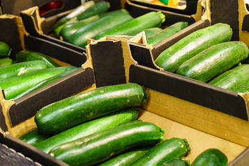 zucchini in wooden shop boxes
