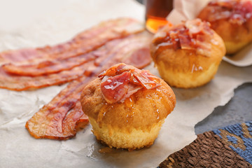 Tasty bacon muffin on table