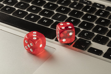 red color dices on keyboard