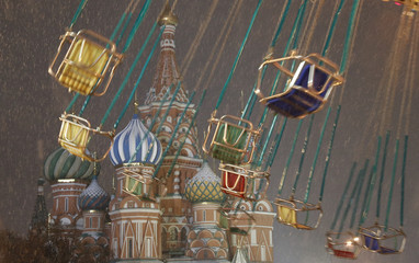 A merry-go-round turns in front of St. Basil's Cathedral in Red Square in Moscow