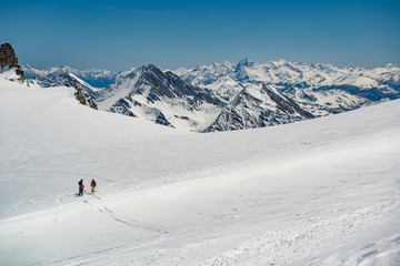 Fototapeta group of people exploring glacier or snowy land walking with alpine ski. Europe Alps Mont Blanc massif mount. Winter sunny day, snow, wide shot.Exploring and travelling
