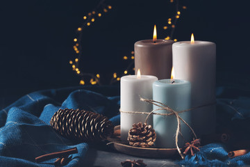 Candles for cold weather. Christmas celebration or cold winter evening concept