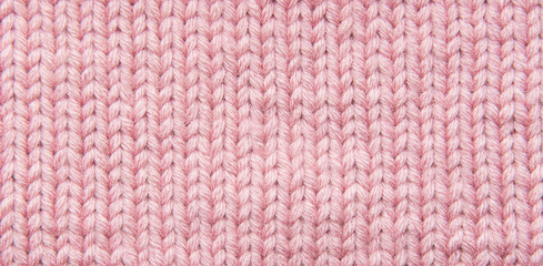 stockings with knitting needles and pink woolen thread
