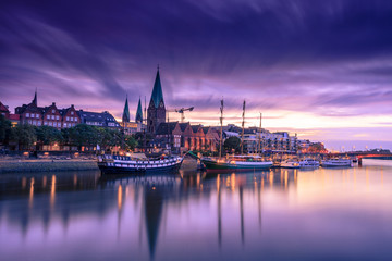 Morning Skyline of  Bremen Old Town as seen over Weser river. Long exposure, artistic filters applied