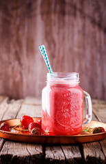 Strawberry Smoothie,Drink in a glass Jar for Drinks on Vintage wooden background.Food or Healthy diet concept.Vegetarian.Copy space for text. selective focus
