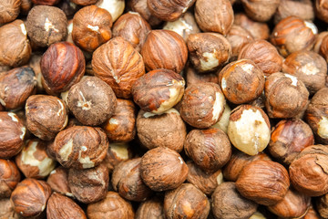 Close up top view of nuts hazelnut. Oriental treats. Background of nuts texture.