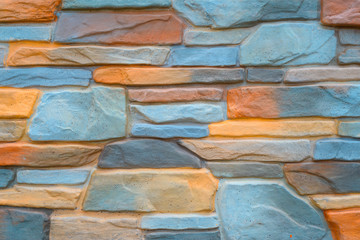 Multicolored stone wall background for art design.