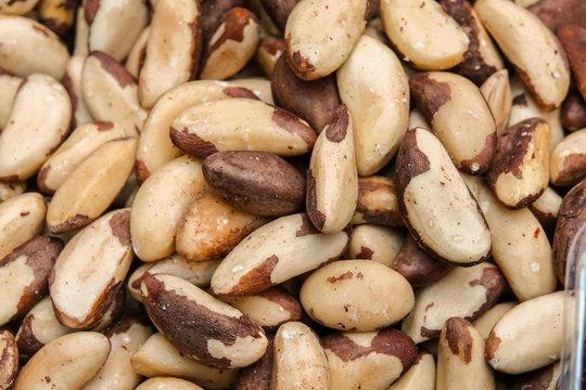 Tasty brazilian nut background. Horizontal image. Background of nuts texture.