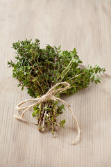 Bunch of fresh organic thyme on a wooden background