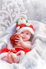 Funny child in Santa Claus costume