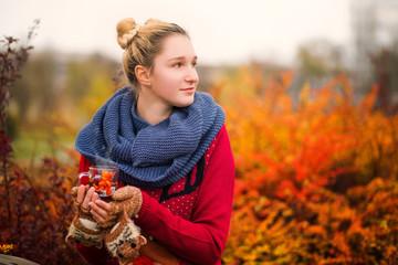 Beautiful girl drinks hot tea