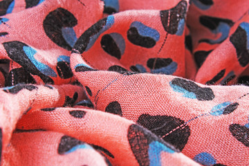 Peach colored animal pattern orange pink fabric dress material cloth texture pattern. Fabric scarf.