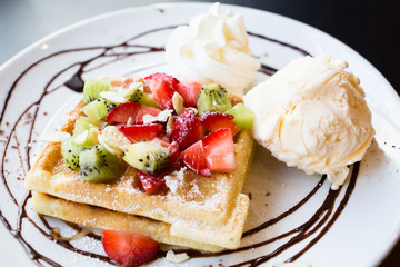 Waffles with fresh berries, whipped cream and ice cream