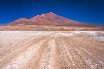 Sandy and gravel desert road through Altiplano