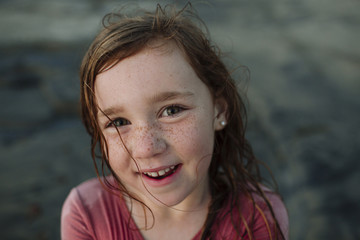 High angle portrait of happy girl at beach