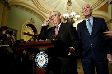 Senate Majority Leader Mitch McConnell, accompanied by Sen. John Cornyn (R-TX), speaks with reporters following the party luncheons on Capitol Hill in Washington