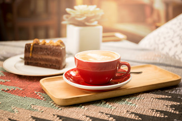 Cup of coffee and piece of macadamia chocolate cake