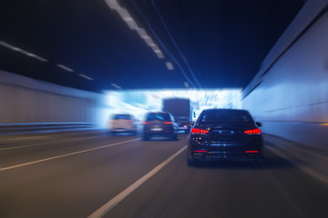 cars leaving tunnel in downtown