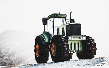 Large heavy duty green tractor on a mountain