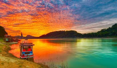 Touristic boat at sunset. Beautiful landscape. Luang Prabang. Laos.