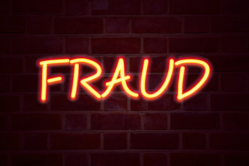 Fraud neon sign on brick wall background. Fluorescent Neon tube Sign on brickwork Business concept for Fraud Crime Business Scam 3D rendered