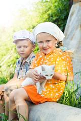Russian children with kitten  in village