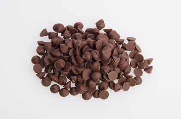 Chocolate chip morsels spread on a background.