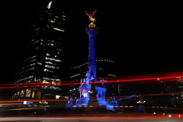 A long exposure picture shows The Angel of independence in Mexico City lit up in Finland's blue and white colours to celebrate the 100 year anniversary of Finland's independence
