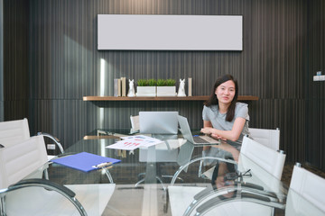 An Asian girl in meeting room in business concept with blank picture