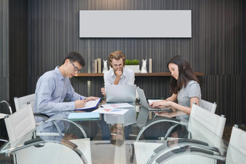 Group of business people thinking in a meeting room, sharing their ideas, Multi ethnic