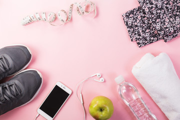Running shoes, phone with fitness accessories
