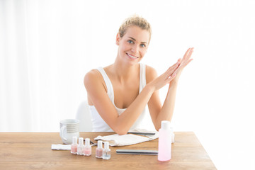 woman drying nail at home. french manicure