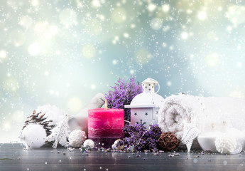 Christmas decoration and Spa on wooden background with free space. Celebration balls and other decoration. Christmas concept