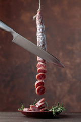Homemade smoked salami with rosemary .