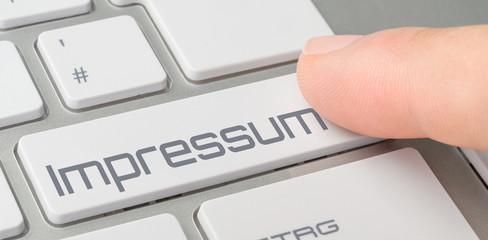 Tastatur mit beschrifteter Taste - Impressum