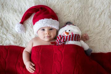 Christmas portrait of cute little newborn baby boy, wearing santa hat