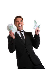 Image of happy businessman in suit with euro at hands