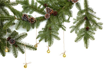 Background with christmas tree branches and hanging glitter balls. Realistic fir-tree border, frame isolated on white. Great for christmas cards, banners, flyers, party posters.