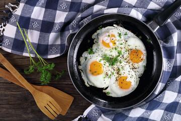 Printed kitchen splashbacks Egg fresh fried eggs sprinkled with parsley