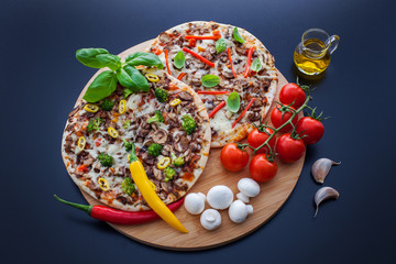 food ingredients and spices for cooking delicious italian pizza