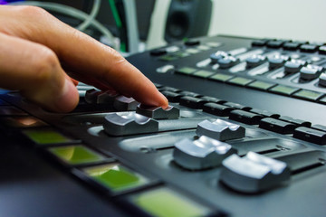 hand on a light, mixing desk fader in blur television gallery