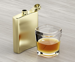 Hip flask and a glass of whiskey