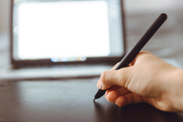 Graphic Tablet Being Used with a Pen by Female Hand