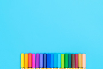 Colorful marker pen on blue copy space background