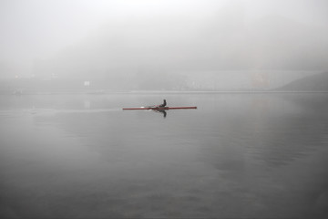 Early morning row in the fog