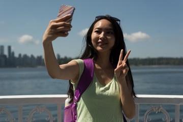 Asian woman taking a selfie in the ferry