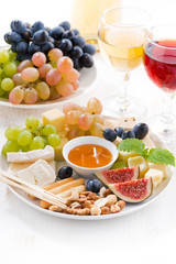 cheeses, fruits, wine and snacks, vertical