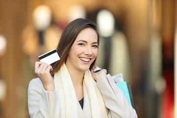 Shopper shopping and showing credit card