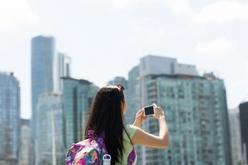 Woman photographing the cityscape