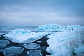 Ice floes floating on the sea surface.